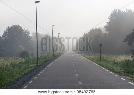Vanishing In Fog Bike And Pedestrian Lane At Misty Morning