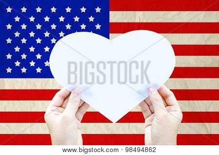 Hand Hold White Heart Paper On United States Of America Flag - Independence Day