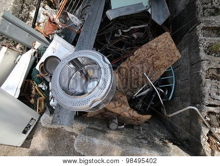 Washing Machine Basket And Rusty Pieces Of Iron In The Landfill Of Recyclable Material
