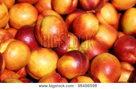 Ripe Nectarines Background For Sale At Vegetable Market