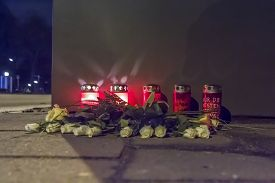 foto of life after death  - Candles and Flowers on a sidewalk after a fatal car accident - JPG