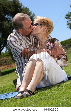 so in love! romantic senior couple kissing