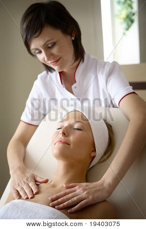Woman getting body massage