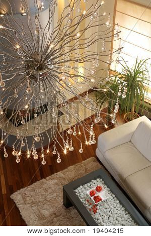 Large ornate chandelier hanging above living room.
