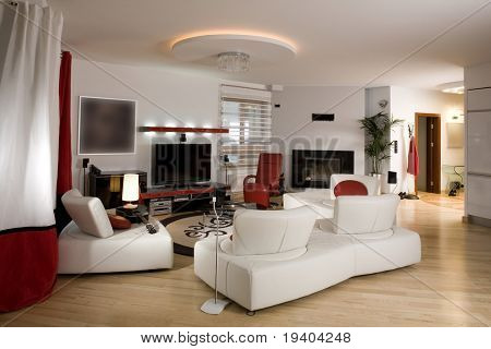 Stylish modern living room with cream settee.
