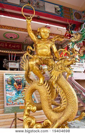 Chinese Children Ride A Dragon.