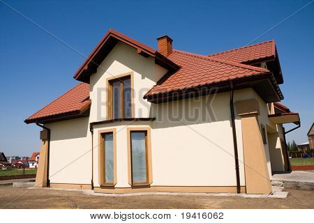 Incomplete single family small yellow house