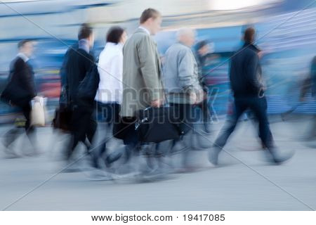 Blurred image of people rushing to work in the morning