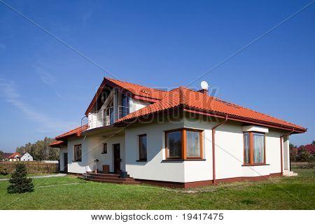 Single family white house against blue sky