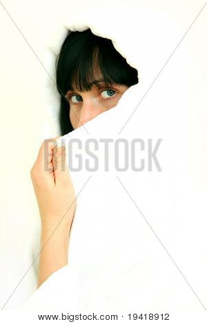 Woman hiding beautiful face behind scarf tissue