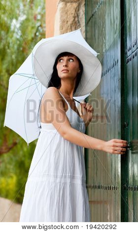Antique antic gate waiting luxury woman with white umbrella