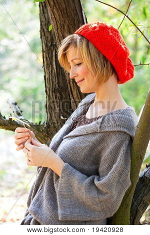 Attractive woman in forest enjoying the weather and time