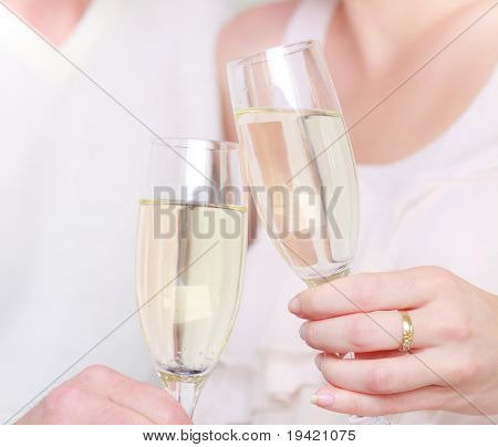 Couple drinking champagne cava in glasses after wedding romantic close up