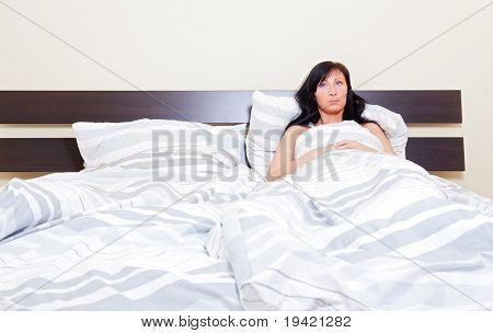insomnia Woman waiting of husband lying alone sleepless while having relationship problems