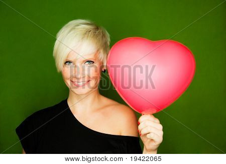 Female couple love girl holding red heart as gift for boyfriend