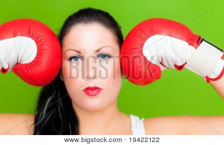 Successful strong fitness woman while box as symbol concept of business emancipation in a men dominating office life