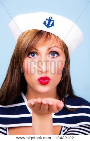 Beautiful attractive dampfer ship girl as concept of maritime vacation trip in summertime with blue background