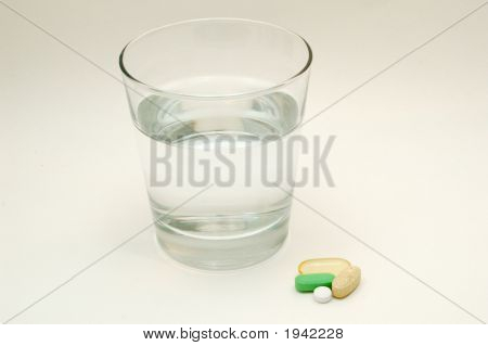 Vitamins And A Glass Of Water