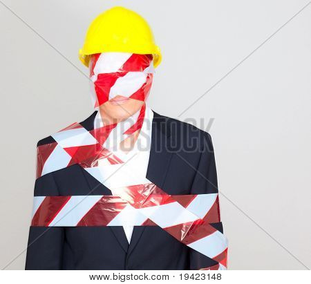 Businessman as home constructor with hat as concept of business organisation