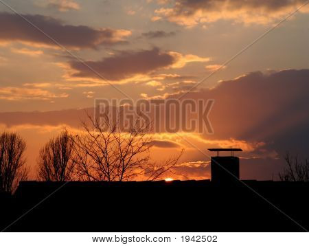 Sunset Behind A Rooftop