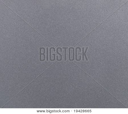 PC notebook metallic silver texture. high magnification of typical silver surface of computer equipment.