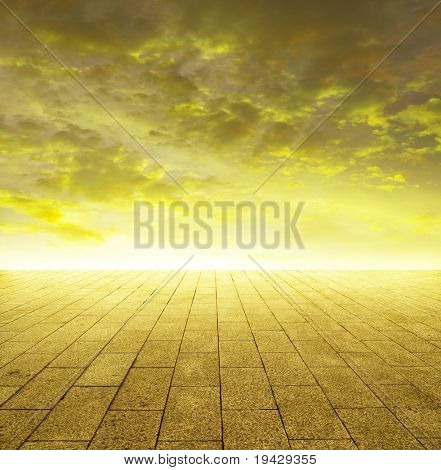 shining golden horizon of stone tiled ground and gold sky with grungy touch