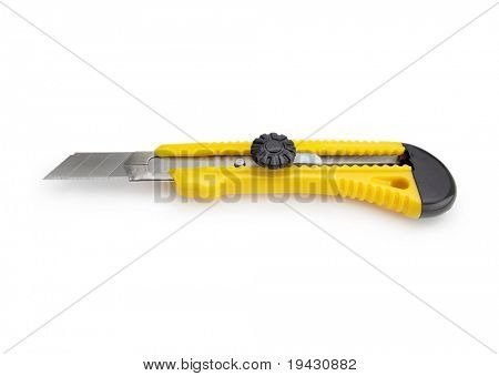 Box cutter knife isolated on white with natural shadow.