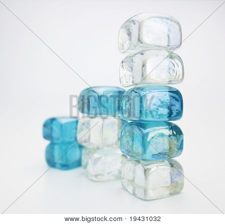 Blue and white glass cubes stacked on Natural white background.
