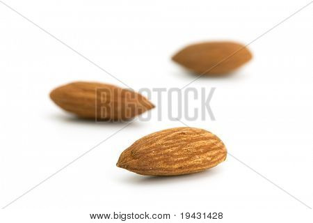 Almonds isolated on white with natural shadow