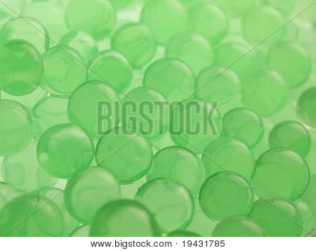 Green polymer gel spheres close up, with depth of view