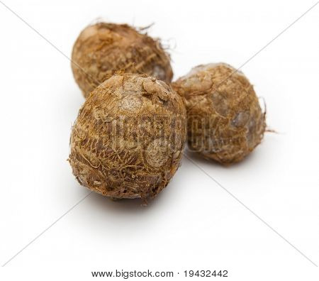 Satoimo potatoes isolated on white
