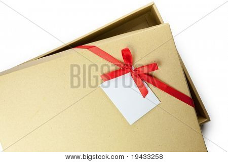 Slightly open present box with red ribbon and blank card. Isolated on white.