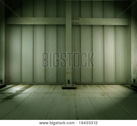 grungy warehouse or factory interior wall and floor.
