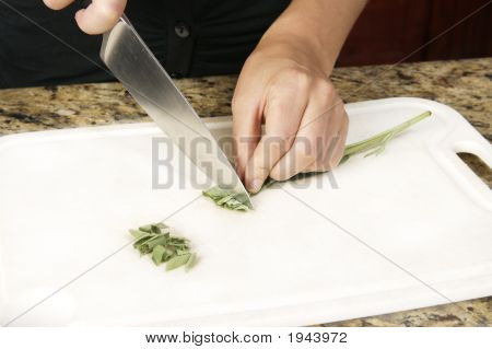 Cutting Sage In Kitchen