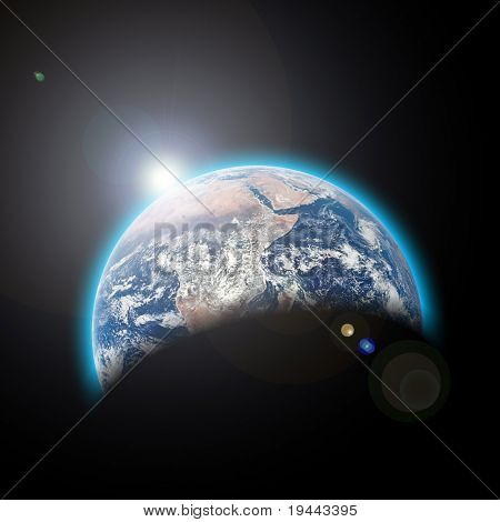 planet earth in space with sunrize
