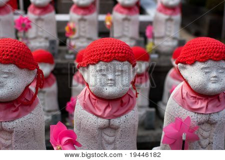 Stock Photo:  Statues of Jizou at a Buddhist temple in Japan.