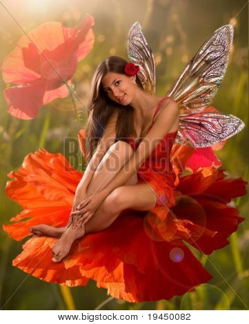 brunette girl elf with  is sitting on a flower poppy