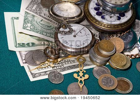 coins, banknotes and antique clocks