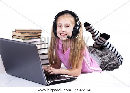 little girl  in Headphones and laptop