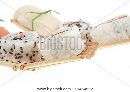 Maki Sushi and Nigiri - Maki Roll made of fresh raw Salmon, Cream Cheese and Avocado inside with Nigiri made of Salmon and Eel. Isolated over white background