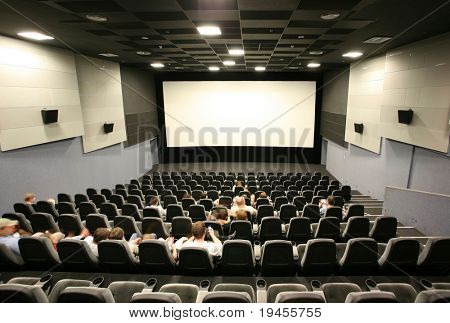 Unrecognizable people in a cinema hall