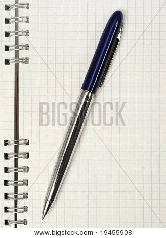 Close up of notebook and pencil