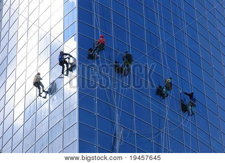 Six workers washing windows