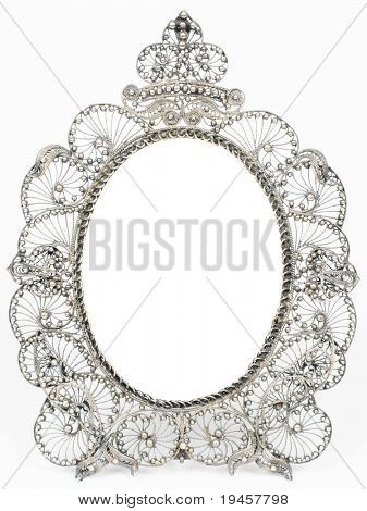 Old antique silver frame over white background