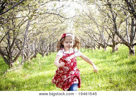 Little Girl Running and Playing Outside