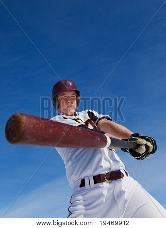 A baseball player taking a swing during spring training