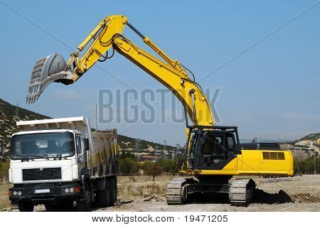 Excavator loading a truck