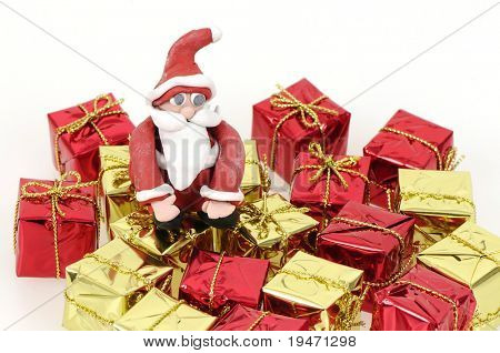 Santa Claus holding several Christmas gifts concept clays designed and created by myself.