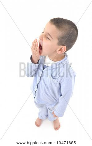 White background studio image little cute boy wearing pajamas yawning  .