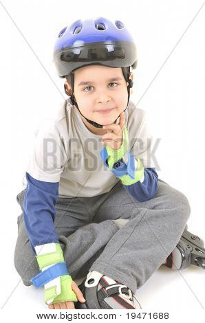 Little boy wearing helmet ride on roller skates White background studio image.